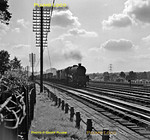 """Stanier LMS """"Jubilee"""" 4-6-0 No. 45556 """"Nova Scotia"""" is approaching the water troughs at Bushey with a down fitted freight on the afternoon of Thursday 13th September 1962. B&W Neg No. 189."""
