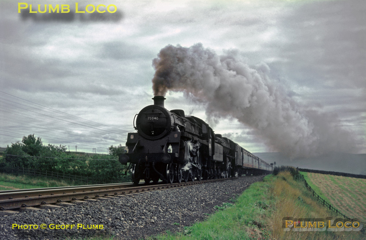 At Shap Wells, nearing the summit, a Blackpool to Dundee express is double-headed by BR Standard 4MT 4-6-0 No. 75040 and Black 5 4-6-0 No. 44892, both engines working hard with the heavy train. 75040 was one of the Oxenholme bankers, added as pilot loco presumably as far as Shap. Saturday 19th August 1967. Slide No. 2994.
