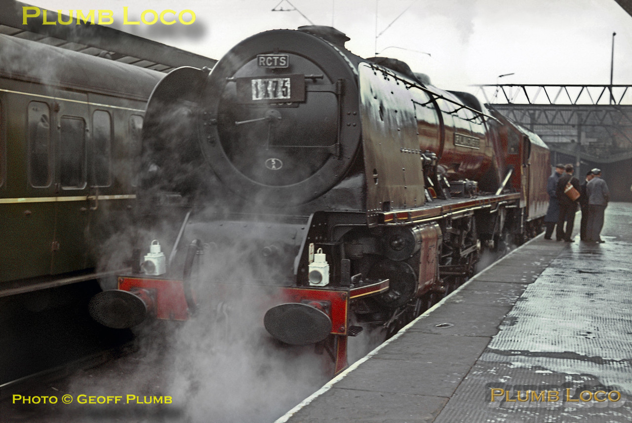 """Carrying the RCTS headboard and Reporting No. 1X75, Stanier """"Princess Coronation"""" Class 4-6-2 No. 46256 """"Sir William A. Stanier, F.R.S."""" stands in the north bay at Crewe station prior to moving off to couple to its coaching stock for the """"Scottish Lowlander"""" railtour which it hauled as far as Carlisle, on its last day in service and the last of its class. Saturday 26th September 1964. Slide No. 1054."""