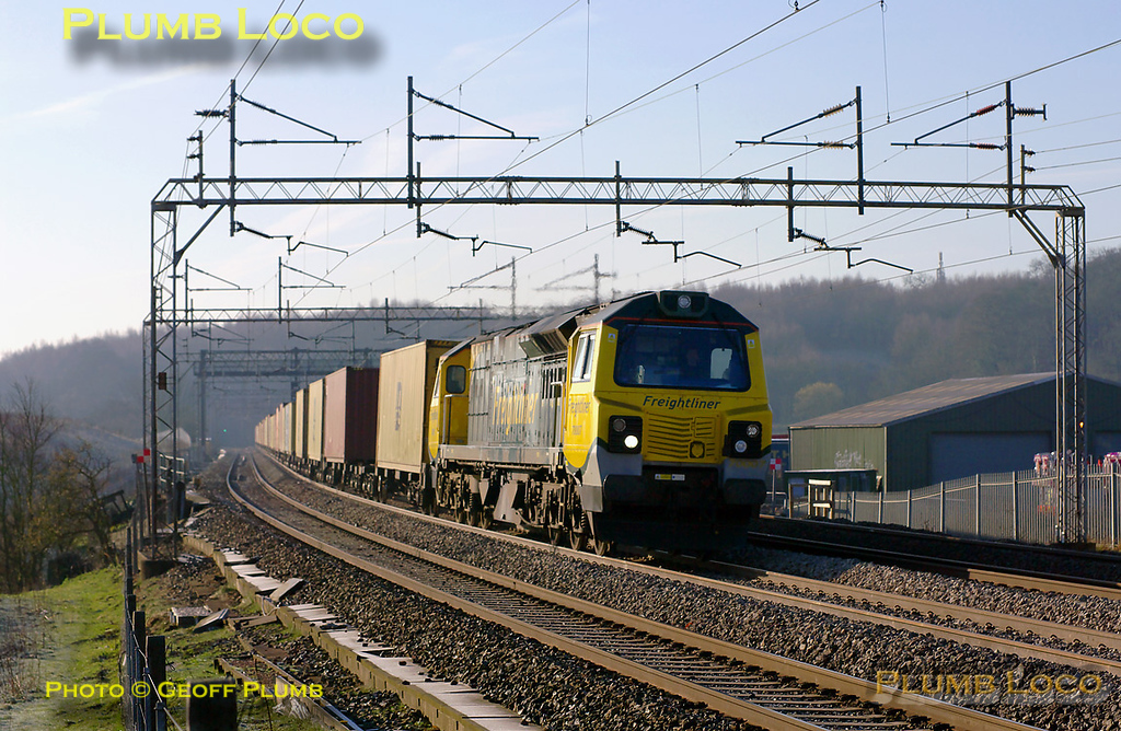 Freightliner 70007 has just emerged from the tunnel at Linslade and is powering past Old Linslade with 4M45, the 03:09 from Felixstowe to Ditton freightliner train, running somewhat late at 08:02 on Saturday 19th March 2011. Digital Image No. GMPI8217.