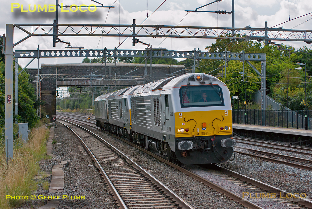 "Another unusual working by Chiltern along the WCML! 67012 ""A Shropshire Lad"" is leading 67015 ""David J. Lloyd"" and DVT 82301 north along the down slow line at Cheddington. This was 5Z67, the 10:40 from Willesden TMD to Crewe IEMD where 67015 was to be dropped off for repairs after its failure the week before. 67012 was then to continue to Brush Loughborough to drop off 82301 which is to have an ETS generator fitted. 11:23, Monday 15th August 2011. Digital Image No. GMPI10032."