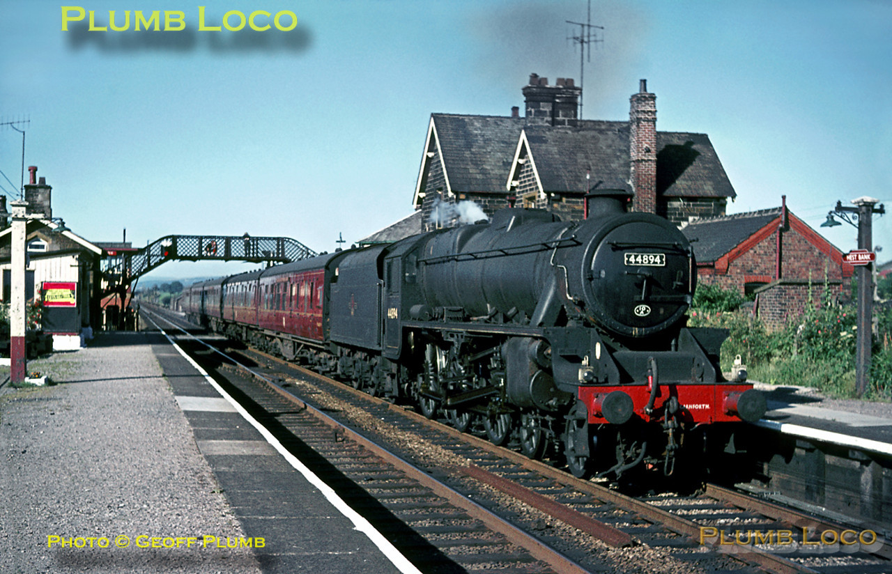 """""""Black 5"""" 4-6-0 No. 44894 looks quite smart as it draws its train to a stop at Hest Bank station on the afternoon of Thursday 21st July 1966. It is carrying Class 1 headcode lamps and the five coach train is the """"Lake Windermere Cruise"""", stopping here before setting off towards Morecambe. The engine has its 10A shedcode painted on the smokebox door, also """"Carnforth"""" painted on the bufferbeam to make doubly sure! Slide No. 2297."""