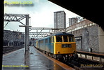 """After a heavy April shower, the sun is trying to come out again as double-headed electric engines arrive at Euston with an up express, 1A54. Both engines are Class AL6 (later Class 86), the leading engine is No. E3166. This later became 86216 """"Meteor"""". April 1970. Slide No. 4752."""