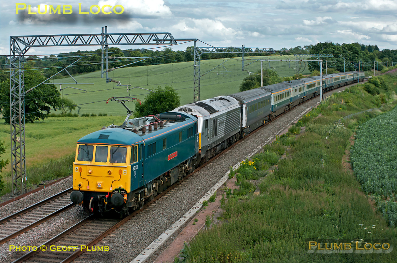 "The ""Three Peaks Challenge by Rail"" special, 1Z50, ran once again this year in aid of the Railway Children Charity. Due to depart from Euston at 15:54, it was delayed by difficulties with the coaching stock, eventually leaving around 20 minutes late. 86101 ""Sir William A. Stanier FRS"" leads the 11 coach train together with 67013 ""Dyfrbont Pontcysyllte"" soon after passing Roade and approaching Blisworth at 17:13 on Thursday 23rd June 2011. The electric loco was working as far as Crewe, the 67 then taking over for the run to Bangor and the first climb for the participants of Snowdon. Digital Image No. GMPI9512."