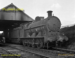 Ex-LNWR Class G2a 7F 0-8-0 No. 49093 simmers outside the sub-shed at Leighton Buzzard on the evening of Saturday 14th April 1962. This location is now covered by a housing estate. B&W Negative No. 74.