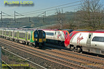 A busy moment on the WCML! Pendolino 390 026 is overtaking 350 233 as they head north at Old Linslade, while southbound 390 047 is about to pass between them on the up fast line. Old Linslade, 08:44, Wednesday 28th March 2012. Digital Image No. GMPI11383.