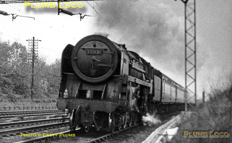 """BR Standard """"Britannia"""" 4-6-2 No. 70031 """"Byron"""" is hard at work with a parcels train on the up slow line at Gypsy Lane, just north of Watford Tunnel on Saturday 2nd November 1963."""