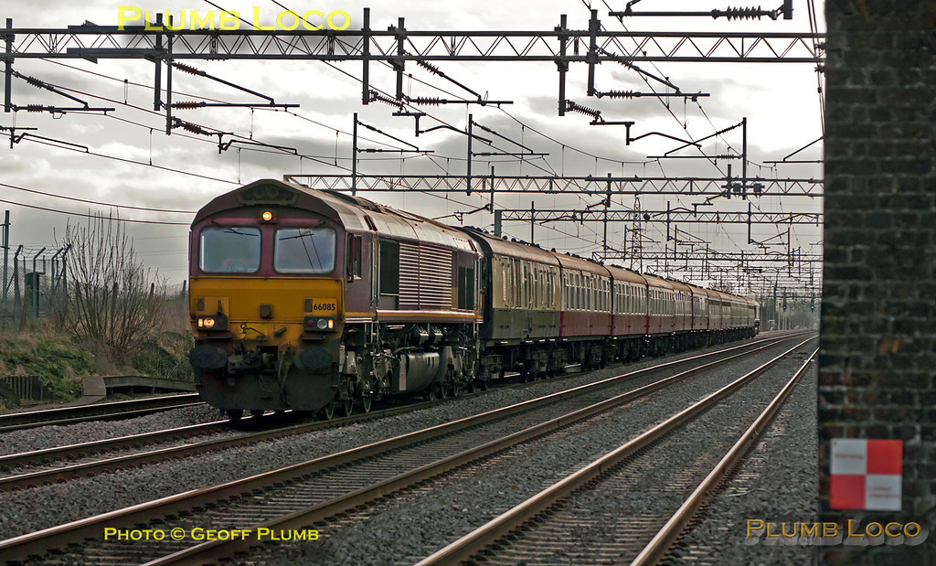 """66085 is topping the train whilst 66213 is on the rear as they approach Cheddington station on the down slow line. This is """"The Concrete Cow"""", 1Z74, 07:49 from Paddington via Southall, Brentford, Colnbrook, West Drayton, Acton Wells to Wembley Yard and Sudbury Junction. The train then continued as 1Z75 to Watford Junction, Milton Keynes and Wolverton Works. Then to Northampton and reverse to Bletchley and across the flyover for another reversal to Fenny Stratford, then Bletchley, Watford Junction and Wembley Central to arrive into Euston at 17:33 - quite a tour! 12:51, Saturday 21st January 2012. Digital Image No. GMPI10836."""
