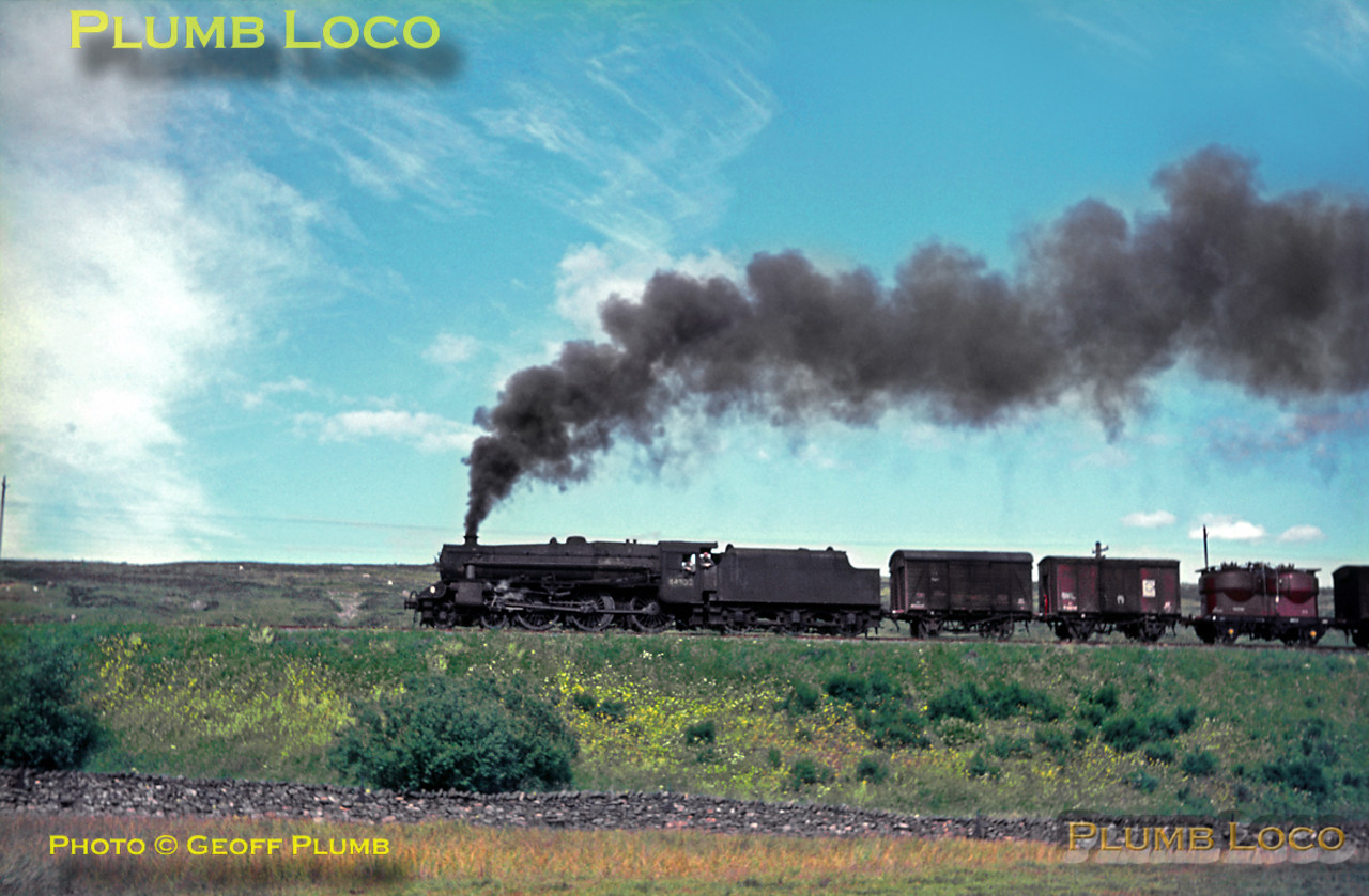 """Black 5"" 4-6-0 No. 44902 is slogging away up the gradient of 1 in 75 towards Shap summit near Scout Green hauling another goods train banked by 2-6-4T No. 42210. Monday 18th July 1966. Slide No. 2217."