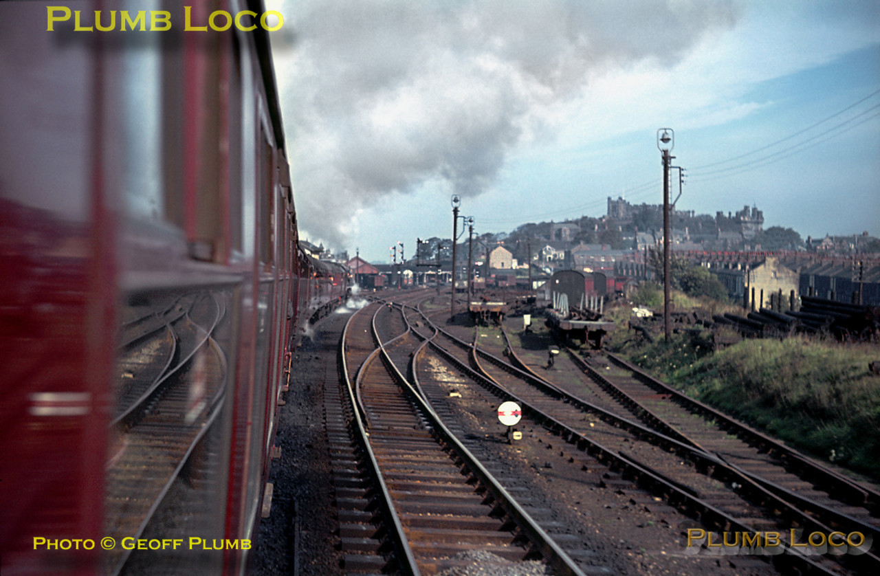 "View from the train as it approaches Lancaster station from the south. This was the RCTS ""Scottish Lowlander Railtour"" from Crewe to Carlisle and on to Edinburgh via the Waverley route, Glasgow and Kilmarnock back to Carlisle and Crewe. Crewe to Carlisle and return was worked by ""Princess Coronation"" class 4-6-2 No. 46256 ""Sir William A. Stanier FRS"" on its last trip. Saturday 26th September 1964. Slide No. 1059."