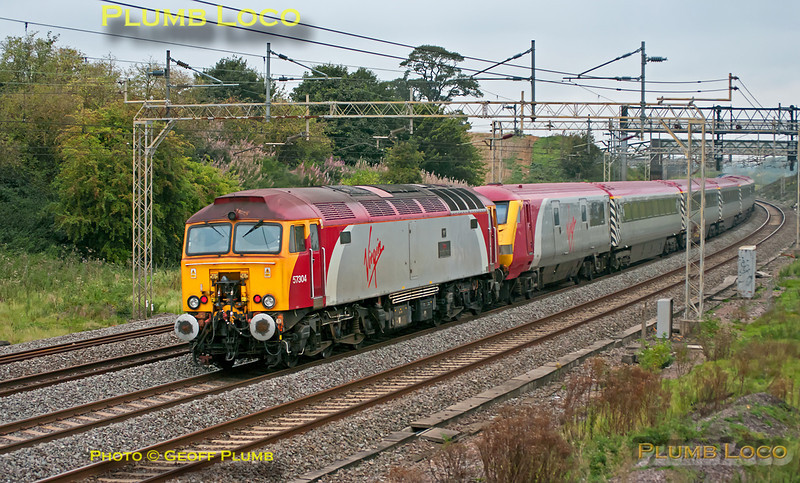 """With the weather back to its normal dull and miserable, 50044 """"Exeter"""" is heading north along the down slow at Old Linslade with 1Z50, the 08:12 from Euston to Holyhead """"The Snowdon Ranger"""". This was a two-day tour, working to Llanrwst the following day before returning to Euston. It was originally planned to be operated by two Class 50s but 50049 was not available, so the train has 57304 """"Gordon Tracy"""" on the rear of the Virgin """"Pretendalino"""" set of Mk.3 coaches. 09:13, Saturday 3rd September 2011. Digital Image No. GMPI10230."""
