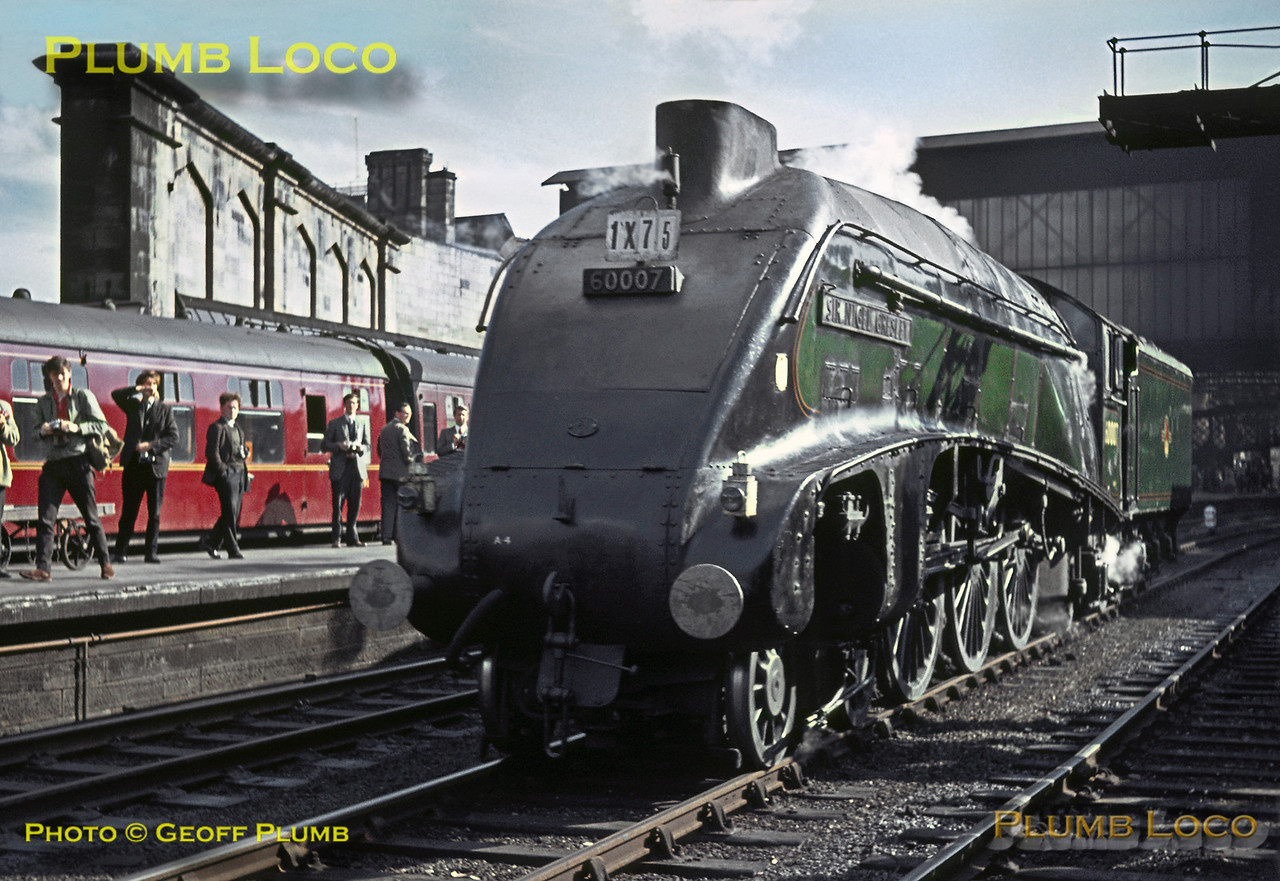 """LNER A4 4-6-2 No. 60007 """"Sir Nigel Gresley"""" took over from 46256 """"Sir William A. Stanier, F.R.S."""" at Carlisle Citadel station for the next leg of the RCTS """"Scottish Lowlander"""" railtour to Edinburgh via the Waverley route. The loco stands on the through line at the station before coupling up to the stock on Saturday 26th September 1964. Slide No. 1063."""