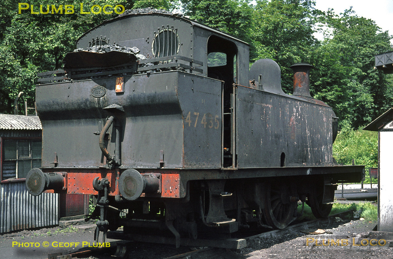 "LMS ""Jinty"" 0-6-0T No. 47435 is temporarily reduced to an 0-4-0T outside Bletchley MPD as it undergoes some attention on Saturday 26th June 1965. Slide No. 1377."
