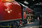 """Stanier LMS """"Duchess"""" 4-6-2 No. 46245 """"City of London"""", in immaculate condition, sits in the roundhouse at Willesden Junction MPD (1A). In the background is a Class 20 Bo-Bo diesel, whilst a small boy and his father wander round the shed. Saturday 12th October 1963. Slide No. 421."""