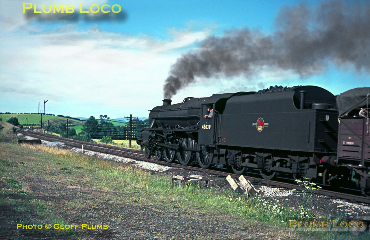 """Black 5"" 4-6-0 No. 45039 has recently gone through works and is in quite clean plain black livery. It is heading north at Hincaster Junction with a cattle train, something that disappeared from the network a long time ago! Friday 22nd July 1966. Slide No. 2322."