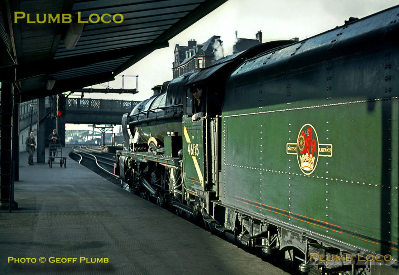 """LMS rebuilt """"Royal Scot"""" class 4-6-0 No. 46115 """"Scots Guardsman"""" has just arrived at Carlisle Citadel station at the head of the RCTS """"Rebuilt Scot Commemorative"""" railtour from Crewe via the Settle & Carlisle line and basks in the winter sunshine. Saturday 13th February 1965. Slide No. 1188."""