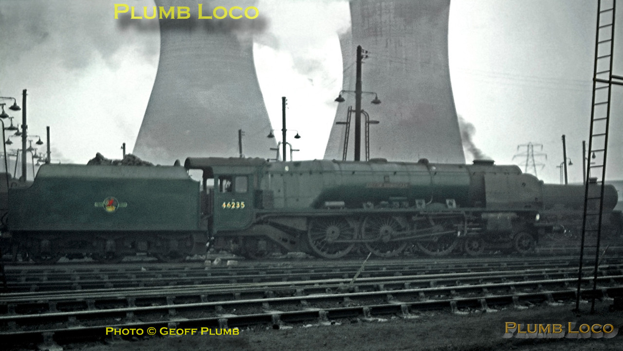 "Not a brilliant photo, taken on an incredibly dull day at Willesden MPD, LMS Stanier ""Princess Coronation"" Class 4-6-2 No. 46235 ""City of Birmingham"" simmers on shed, with the cooling towers of Acton Power Station dominating the background. Beyond 46235 is an unidentified ""Jubilee"" 4-6-0. 46235 survived the cutter's torch and is now preserved in Birmingham, still in BR green livery. Sunday 5th January 1964. Slide No. 481."