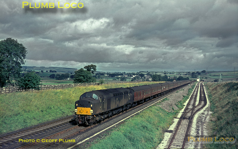 """From the Geoff Plumb Collection of original slides. English Electric Type 4 Class 40 No. D267 is passing the quarry near Shap summit as it heads south with the up working of the """"Royal Scot"""" from Glasgow to Euston on Thursday 26th August 1965. Photo by Mike Burnett."""