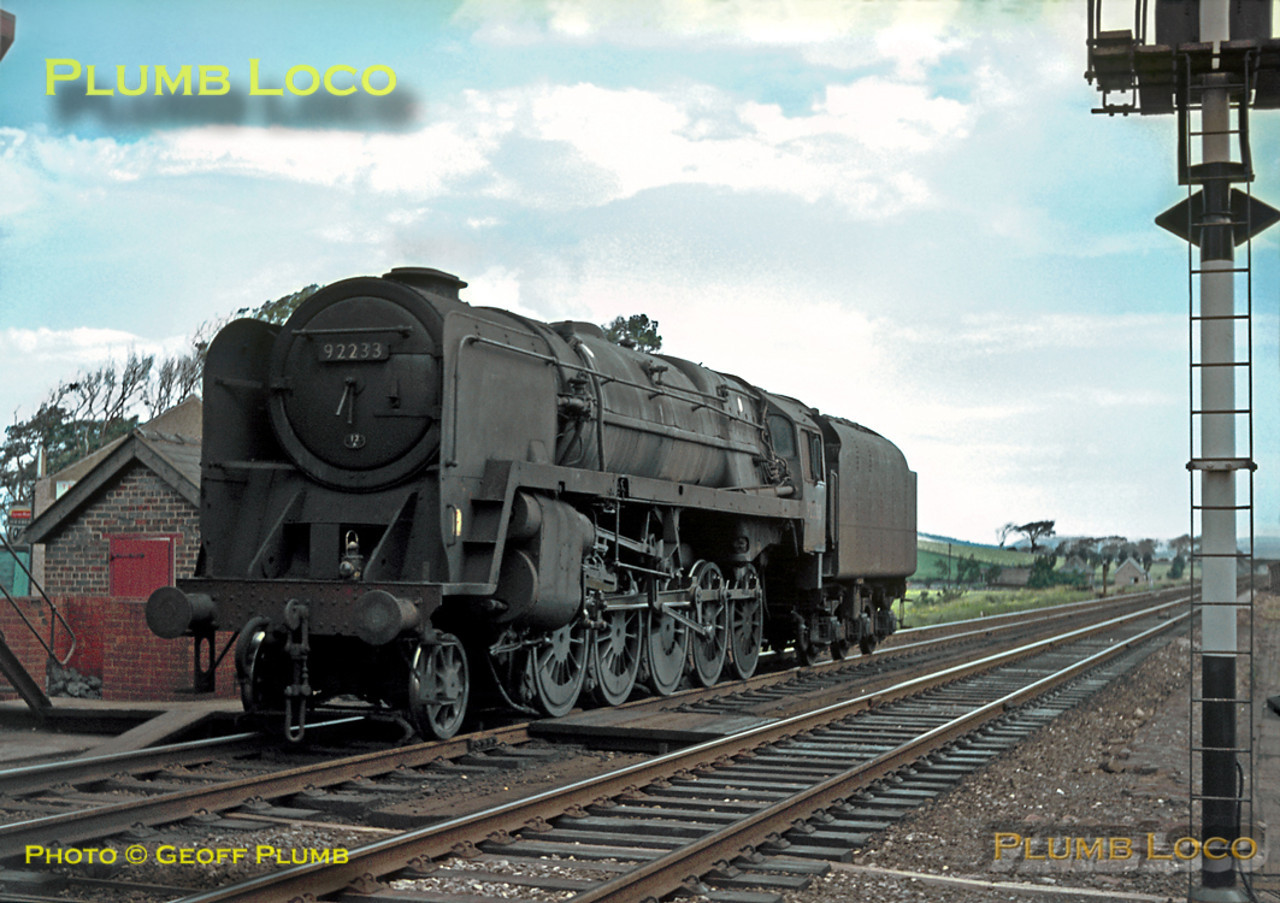 BR Standard 9F 2-10-0 No. 92233 is running tenderfirst light engine at Hest Bank, presumably returning to Carnforth depot for servicing, having just come off the line from Morecambe. Wednesday 20th July 1966. Slide No. 2240.