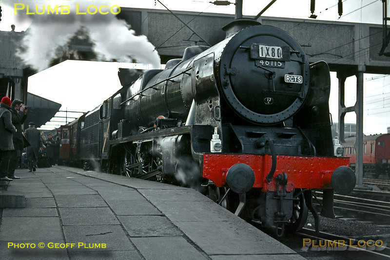 "On a freezing cold Saturday 13th February 1965, LMS rebuilt ""Royal Scot"" 4-6-0 No. 46115 ""Scots Guardsman"" is raring to go as it waits at the head of the RCTS ""Rebuilt Scot Commemorative Railtour"", 1X80, at Crewe station. Departure time was 09:15 and the destination was Carlisle via Blackburn, Hellifield and the Settle and Carlisle line, return via Shap. The nameplates on the engine are wooden replicas, the few survivors of the class expected to be out of service soon after, though in the event a few soldiered on until October 1965. Happily, this engine survived and has now made a return to main line metals. The yellow diagonal stripe on the cabside denoted that the engine was no longer allowed to work south of Crewe under the overhead line equipment. Slide No. 1144."