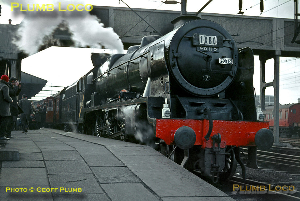 """On a freezing cold Saturday 13th February 1965, LMS rebuilt """"Royal Scot"""" 4-6-0 No. 46115 """"Scots Guardsman"""" is raring to go as it waits at the head of the RCTS """"Rebuilt Scot Commemorative Railtour"""", 1X80, at Crewe station. Departure time was 09:15 and the destination was Carlisle via Blackburn, Hellifield and the Settle and Carlisle line, return via Shap. The nameplates on the engine are wooden replicas, the few survivors of the class expected to be out of service soon after, though in the event a few soldiered on until October 1965. Happily, this engine survived and has now made a return to main line metals. The yellow diagonal stripe on the cabside denoted that the engine was no longer allowed to work south of Crewe under the overhead line equipment. Slide No. 1144."""