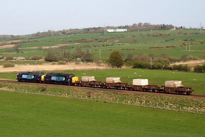 37602, 37603 and their four FNA flasks head for Crewe via Carlisle. 20/04/11.