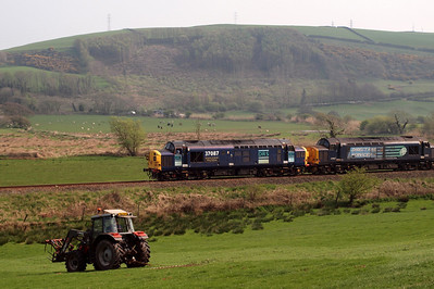 Tractors meet a tractor at Linethwaite. 19/04/11.
