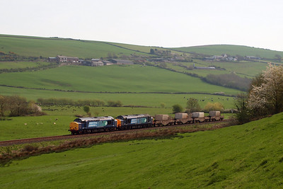 37602 and 37603 approach Linethwaite, revving away from the token exchange at St Bees. 20/04/11.