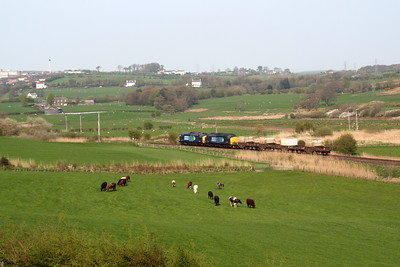 37602 and 37603 approach a farm crossing south of Mirehouse Junction. 20/04/11.