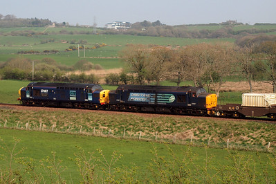 37087 and 37667 catch the sun as they head north towards Carlisle and then on to Crewe - the Kent viaduct at Arnside is blockaded for rebuilding until July, so all flask traffic is diverted via Whitehaven. 19/04/11.