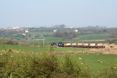 6K73 heads towards Whitehaven - West Cumberland Hospital is visible on the skyline at Hensingham. 19/04/11.
