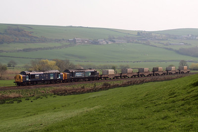 37087 Keighley & Worth Valley Railway and 37667 growl past Linethwaite near St Bees with a mega-haul of six FNA nuclear flasks on the diverted 6K73 1440 Sellafield BNFL - Crewe Coal Sidings. 19/04/11.