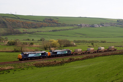 37602 and 37603 work 6K73 1440 Sellafield - Crewe Coal Sidings (diverted via Carlisle Upperby Jns) past Linethwaite near St Bees. 20/04/11.