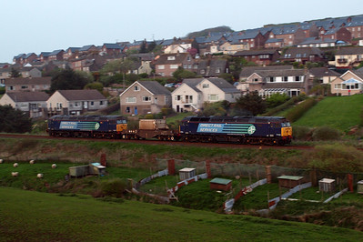 57003 and 57007 top 'n' tailing a single FNA flask wagon on 6C52 Heysham power station - Sellafield, passing Sea Mill at St Bees. 21/04/11.