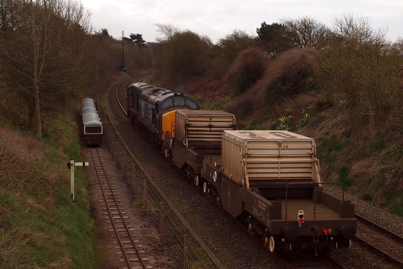20303 & 37409 pass the withdrawn Maxi coaches on the Barrow headshunt at Ravenglass, 02/04/12.