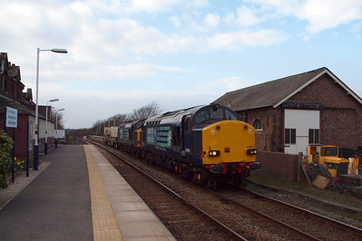 37608, recently repainted, leads 37059 through Ravenglass on 6K73 to Crewe Coal Sidings, 03/04/12.