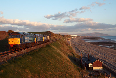57011 & 57002 lead a DIT 37611 past Nethertown in evening light on 6C46 Sellafield - Carlisle Kingmoor flasks, 04/04/12.
