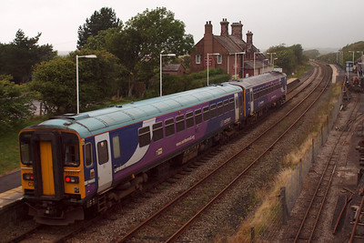 Two Northern Rail Class 153 DMUs arrive at Ravenglass, heading north with the penultimate train of the day at Ravenglass, 10/08/11.