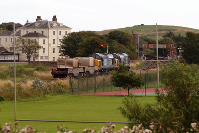 37087 and 37194 slow for St Bees station, for a token exchange. 08/08/11.