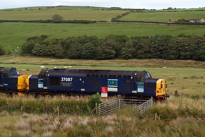 37087 passes a farm crossing near St Bees School. 08/08/11.