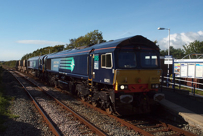 66431 leads newly-repainted 66301 through Ravenglass on 6K73 Sellafield - Crewe Coal Sidings flasks. 09/08/11.