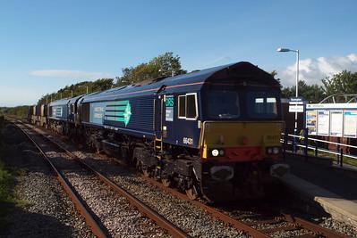 66431 leads newly-repainted 66301 through Ravenglass on 6K73 Sellafield - Crewe Coal Sidings flasks. 09/08/11.