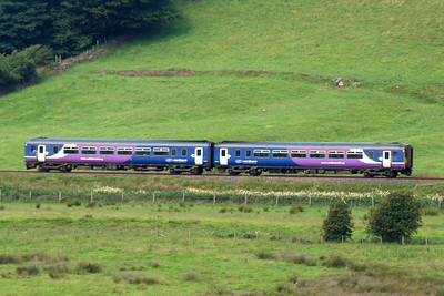 A Northern Rail Class 156 makes its way northwards to Carlisle, seen from Low Walton. 09/07/11.