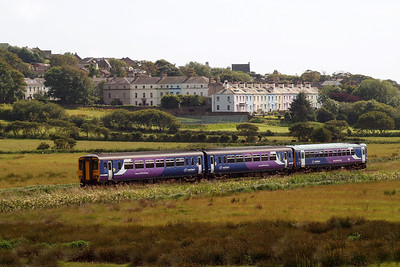 A Class 153 and Class 156 combination heads south into St Bees from Carlisle. 07/07/11.
