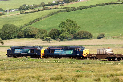 37218 and 37602 leave St Bees behind on 6K73. 07/07/11.