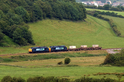 37602 and 37218 run through the green St Bees valley on their way to Sellafield. 09/07/11.