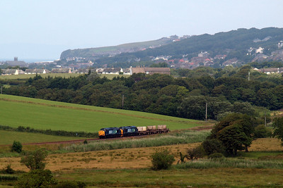 Whitehaven provides a backdrop for 37602 and 37218 on this morning's 6C53 Crewe - Sellafield. 09/07/11.