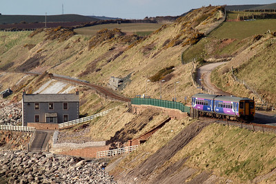 A Northern Rail Class 156 heads north through Nethertown station - no takers today! 30/03/13.