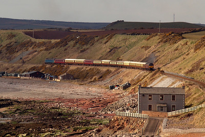 With the stationmaster's house at Nethertown in the foreground, 47826 approaches the camera, heading south along the Cumbrian Coast, 30/03/13.