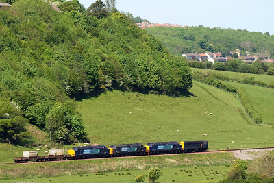 20302 and friends head past Linethwaite, with Mirehouse coming into view, 26/05/12.